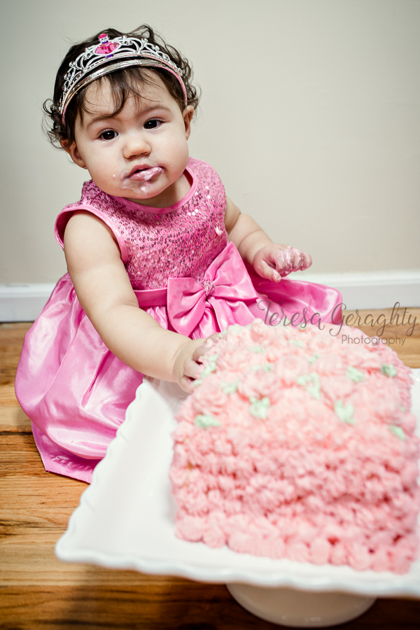 girl in pink dress with pink birthday cake