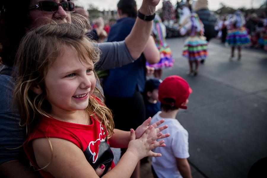 girl watching disney parade