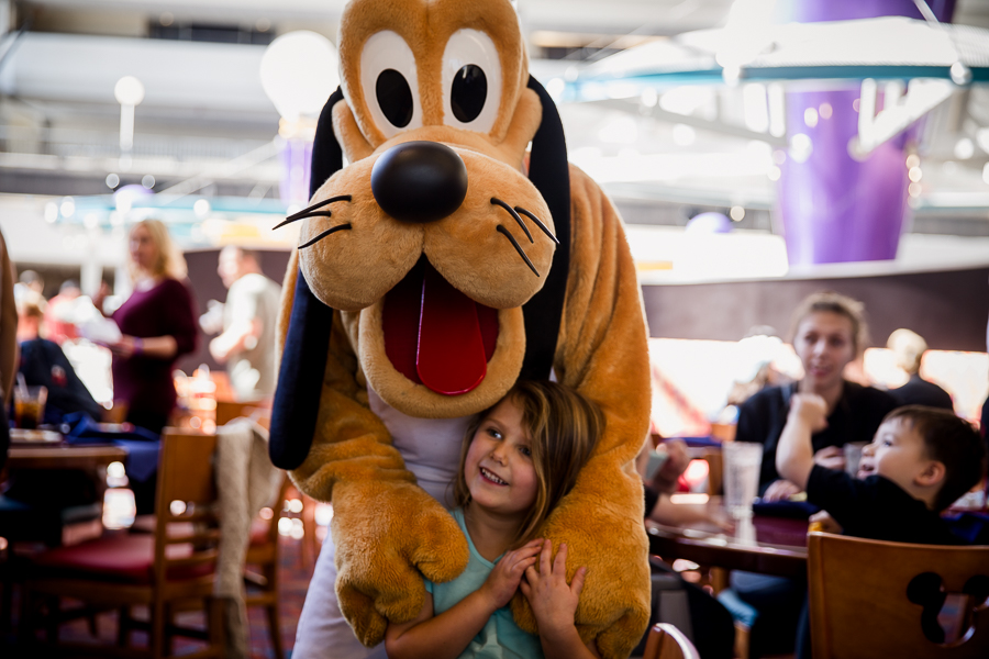 pluto and little girl