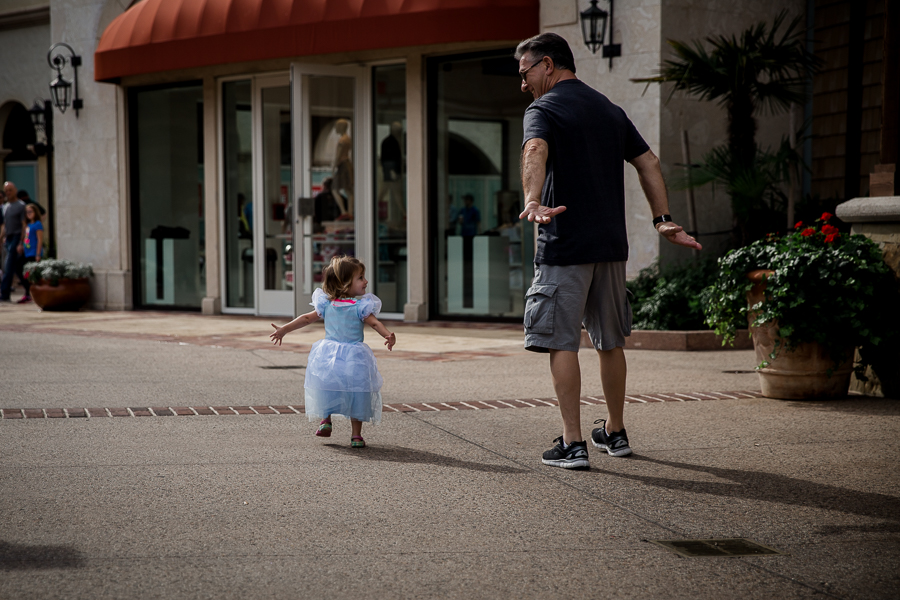 toddler and grandpa walking