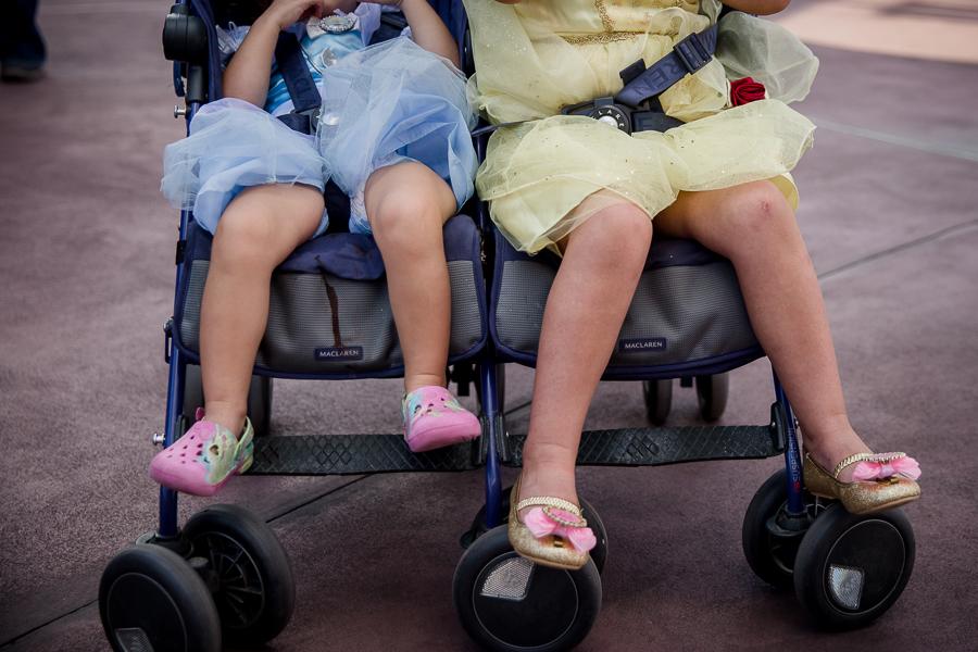 girls in princess dresses in stroller