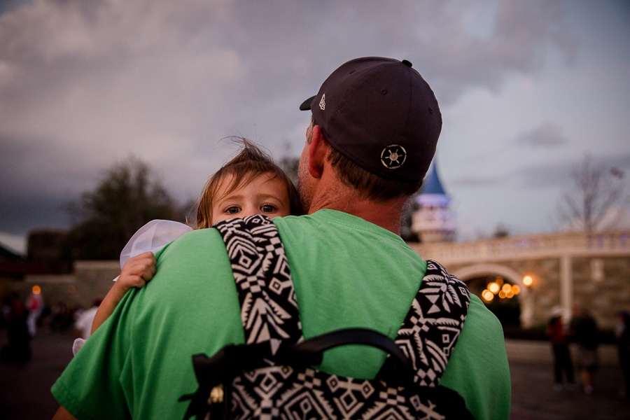girl carried by dad in disney
