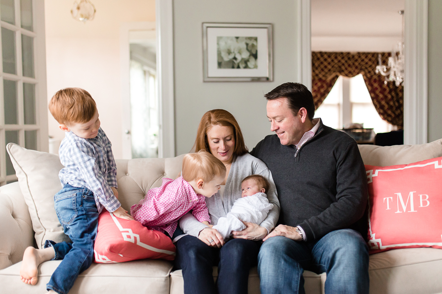 natural reaction of family welcoming newborn in home