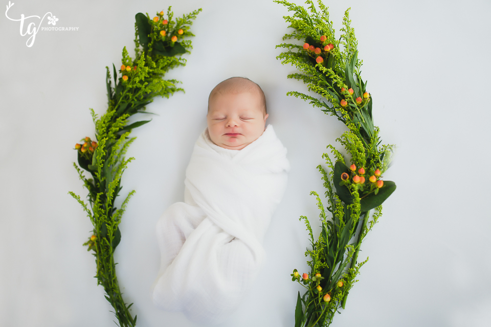 Baby in fall floral wreath