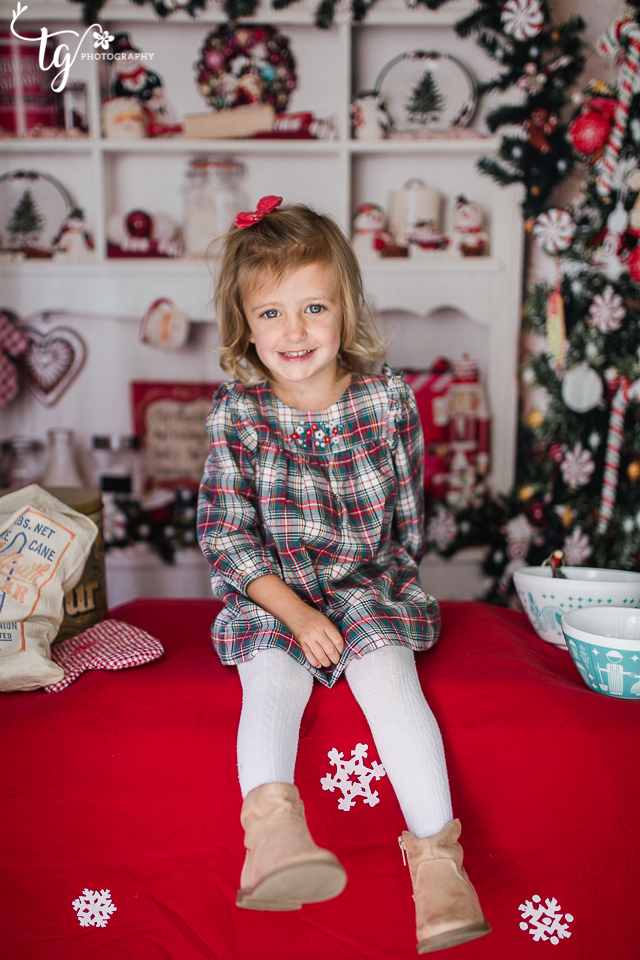 little girl in plaid dress in kitchen christmas set