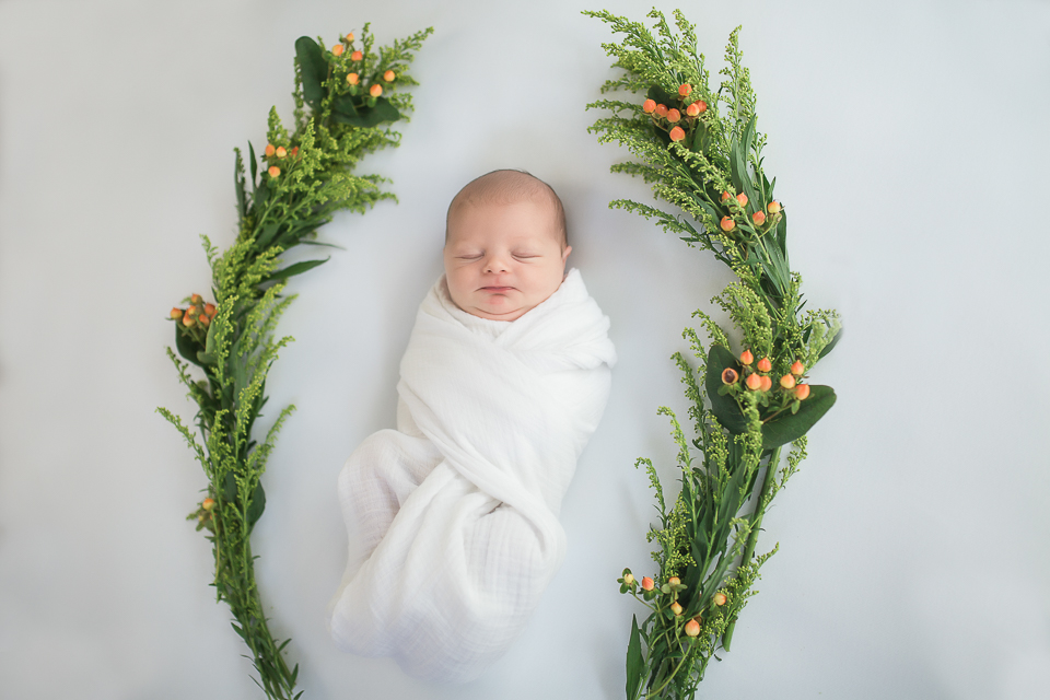 baby boy in fall berry floral wreath