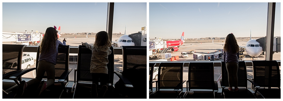 girls watching planes at airport