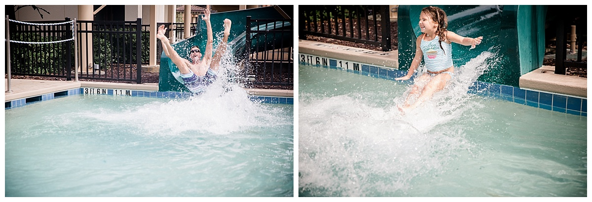 father and daughter splashing in pool