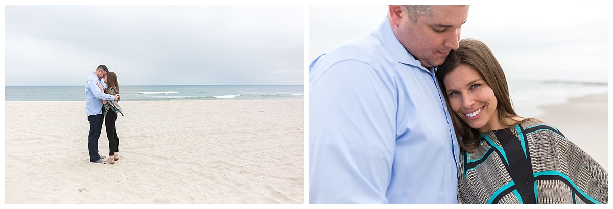 couple hugging on the beach on a cloudy day