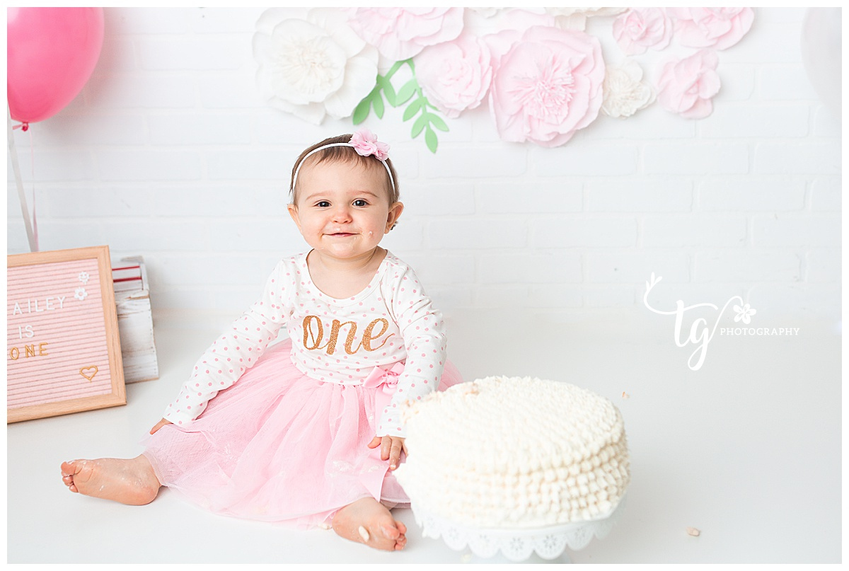pink white and gold first birthday session