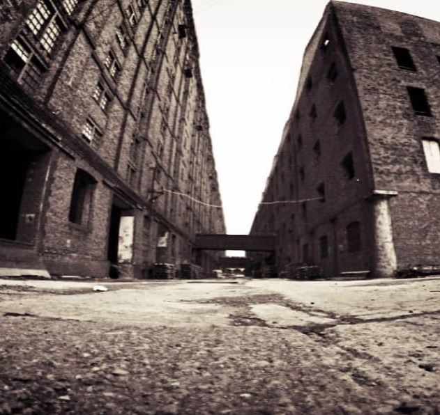 Stanley Dock, Tobacco Warehouse and South Warehouse- Grade II• Listed architecture. #unescoworldheritage #architecture #tobaccowarehouse #stanleydock  #liverpool #dock #tobacco #blackandwhite #oldarchitecture #history #uk #dockroad #worldsbiggestbrickwarehouse