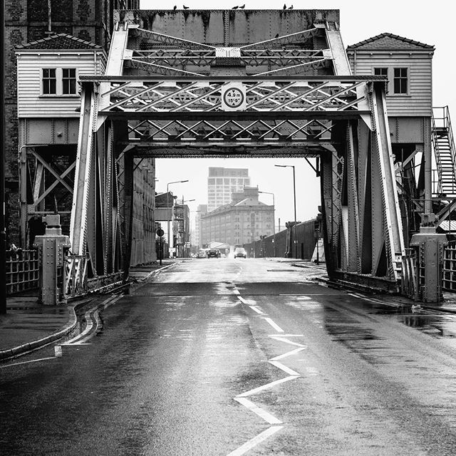Liverpool Dock Apartments and Princess Dock Apartments seen through the Stanley Dock Bridge. #stanley #dock #bridge #liverpool #apartments #bnw #blackandwhite #fineart #road #urban #city #photooftheday #photography #instagood #instadaily #instaphoto #perspective #stanleydock #tobaccowarehouse #liverpool Repost  @marcin_bulinski_photography