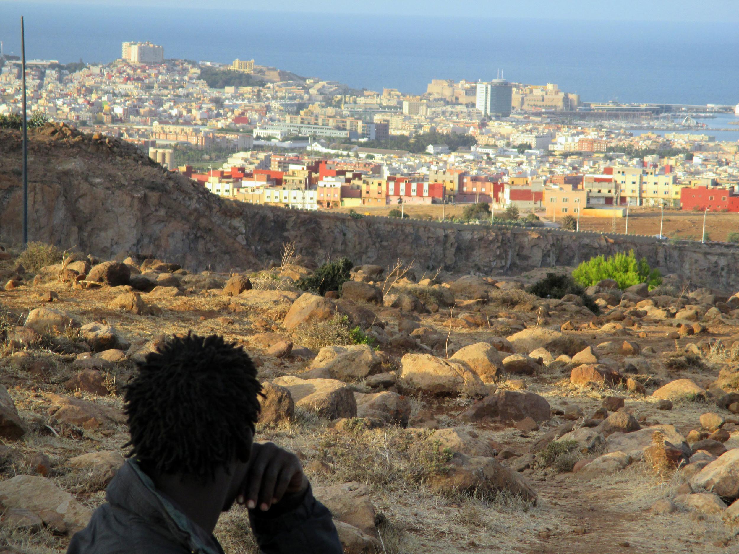 1_MAIN STILL_Abou R looking at Melilla_LES SAUTEURS.jpg