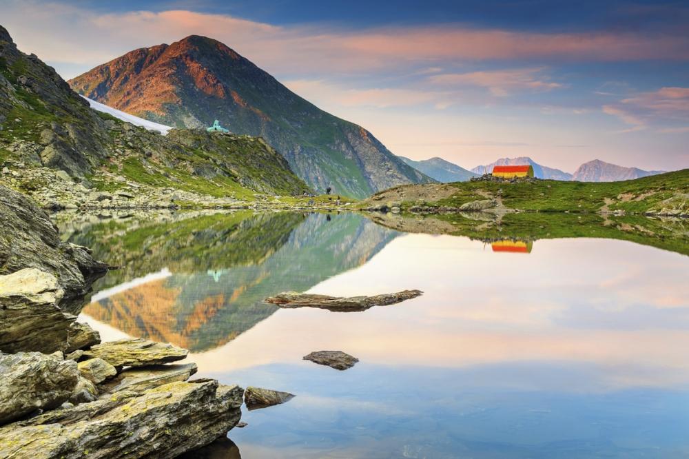 Stunning-glacier-lake-with-magical-sunset,Fagaras,Carpathians,Transylvania,Romania-000069831269_Large.jpg
