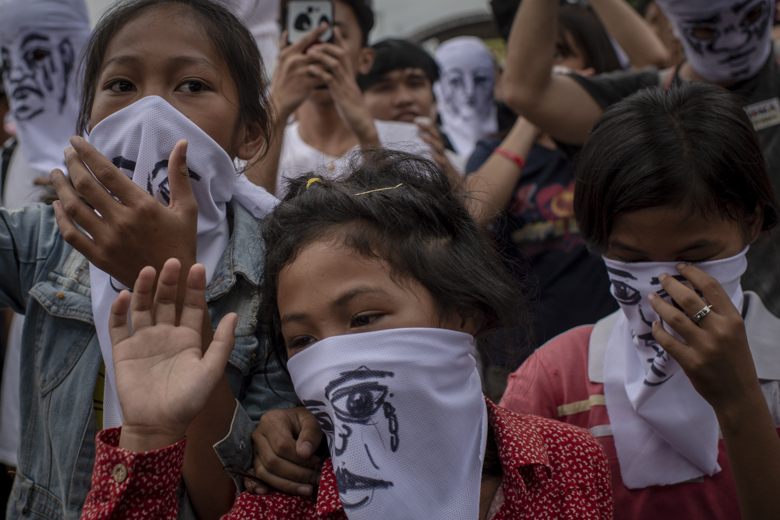Children whose relatives were killed under the government's war on drugs wear masks to conceal their identities in a protest coinciding President Rodrigo Duterte's State of the Nation Address in Quezon City, July 23, 2018.