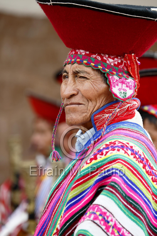 "Quechua man (""varayoc"" or local mayor) dressed in traditional costume outside church, Pisac, Urubamba, Cusco, Peru"