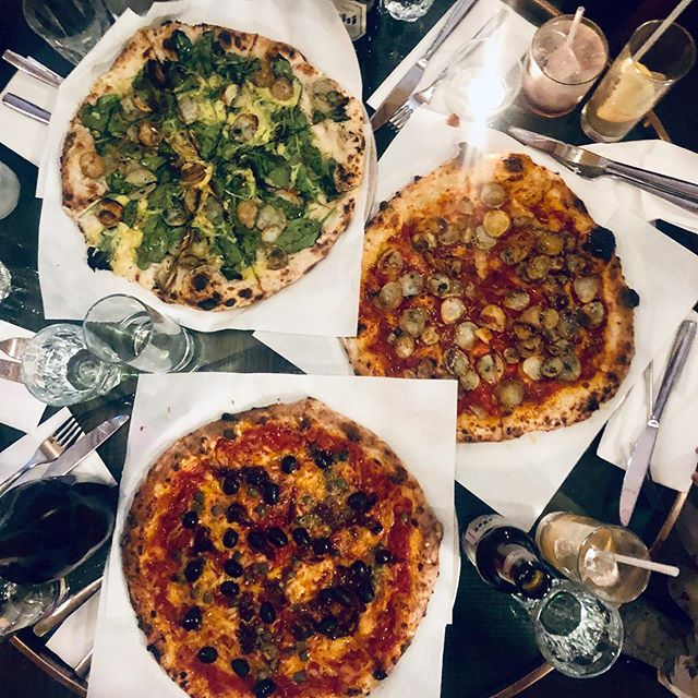 The vegan feast is ready. And you wouldn't even believe they aren't vegan! Finest stone baked sourdough, naughty #vegan toppings and #coconut #cheese. #veganpizza #veganlondon