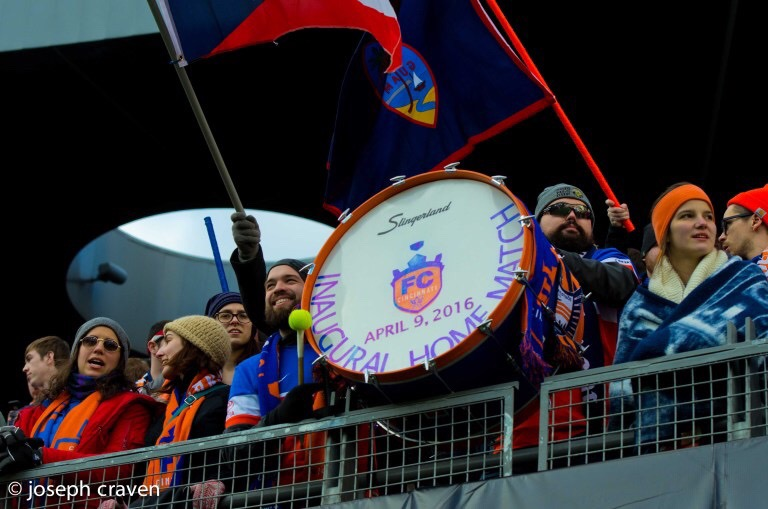 Fox and Bjorn showing off their initial drum for the first home match. Since that April 9th game, they've added a second bass drum and have been joined by several other drummers.