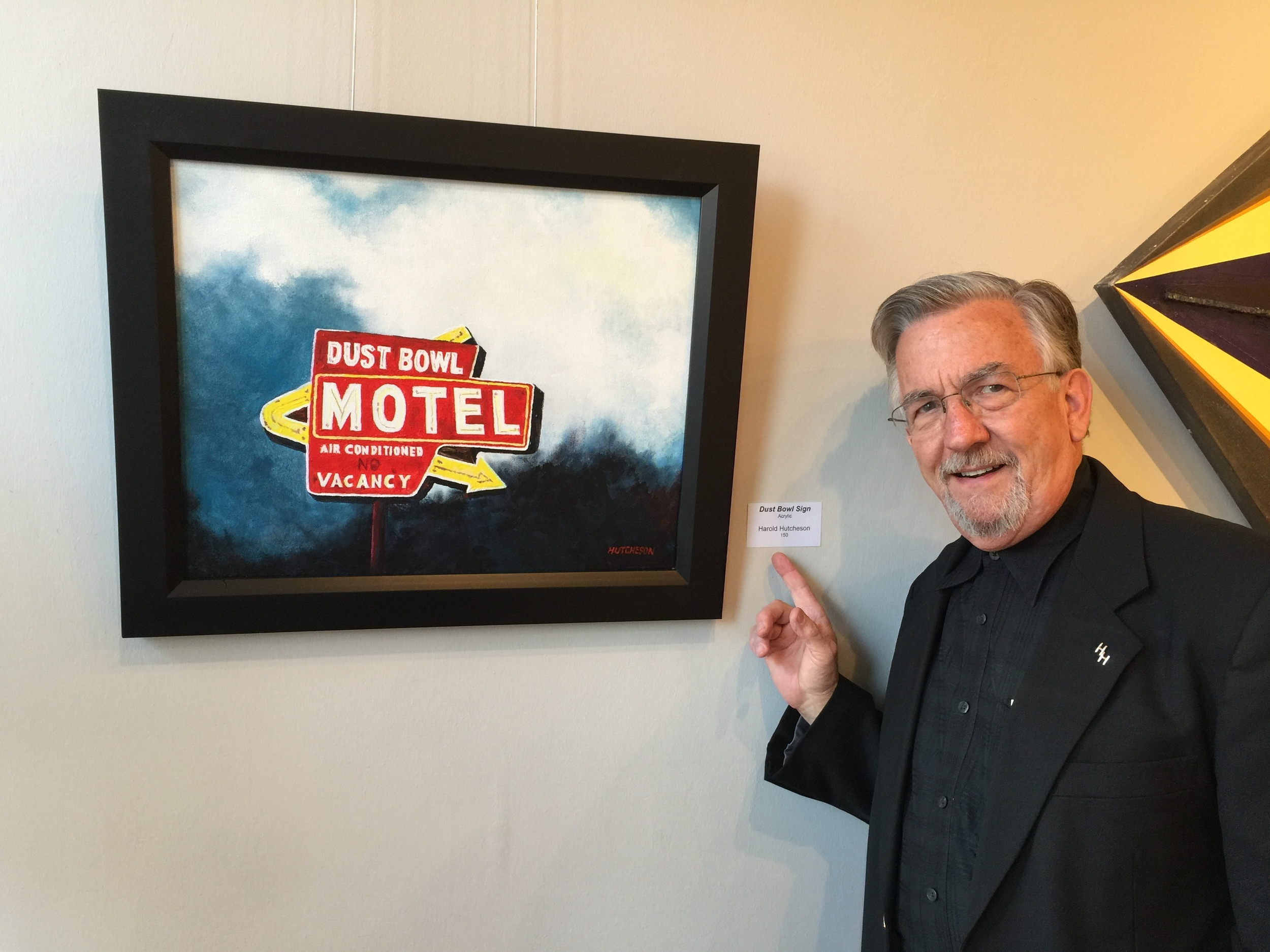 Harold Hutcheson with his painting at the DUST BOWL MOTEL Art Show sponsored by the Conroe Art League.
