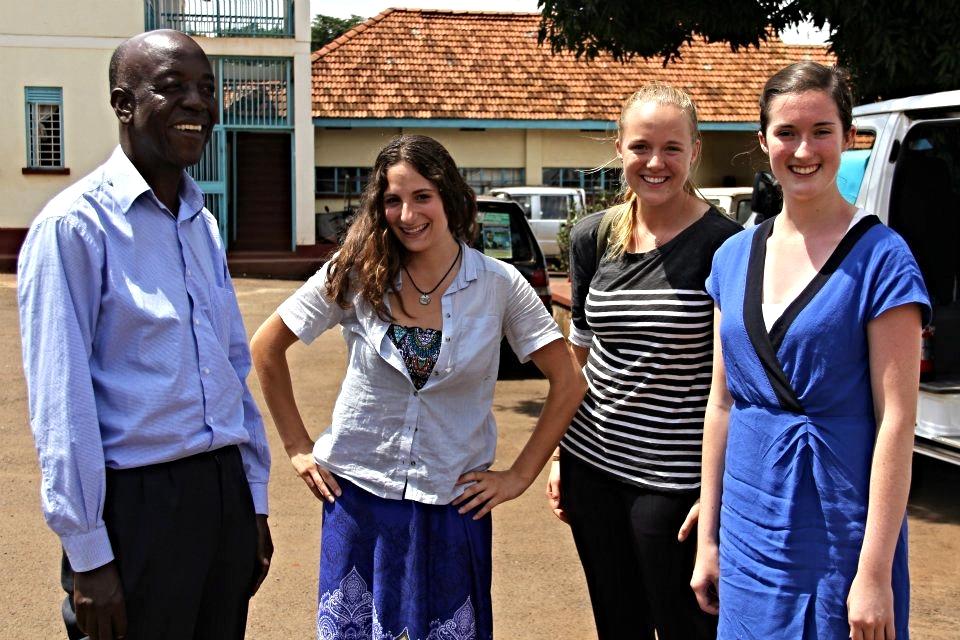 ENFOCO Lab researchers Alyssa Luisi, Colleen Devlin, and Catherine Mahoney with former NaFIRRI Director John Balirwa.