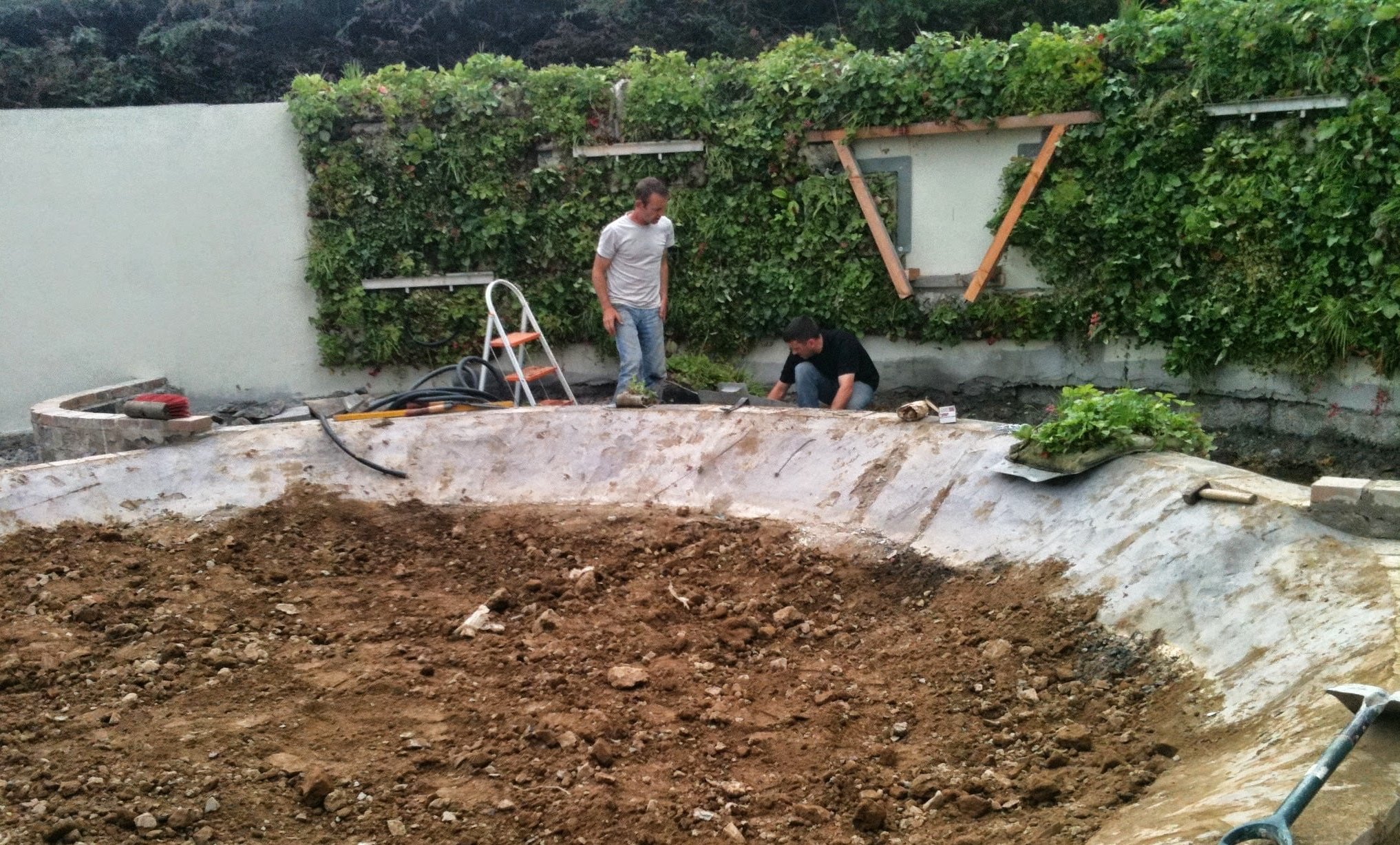 installing pond and vertical planting system.jpg