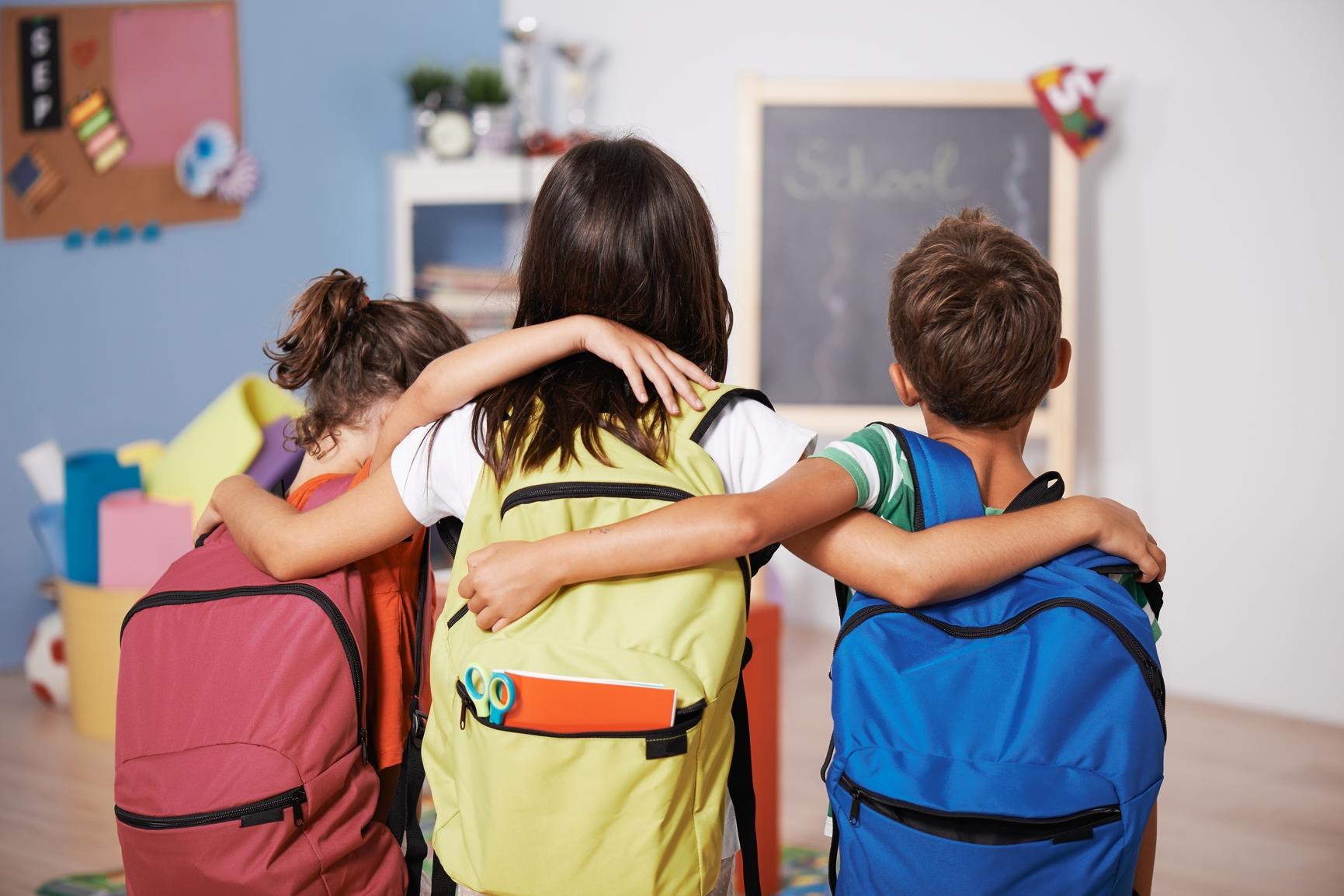 KidsHuggingwBackpacks.jpg