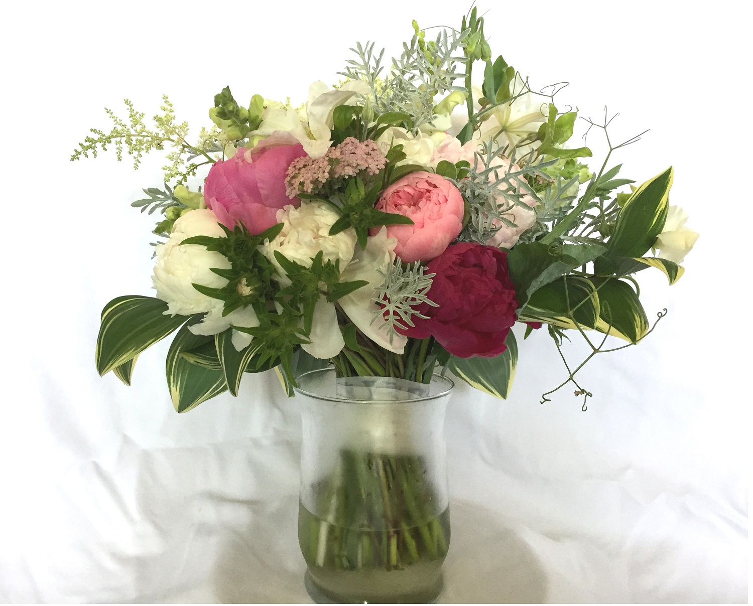 Erica's bouquet—peony, dusty miller, variegated solomon seal, astilbe, stoke's aster