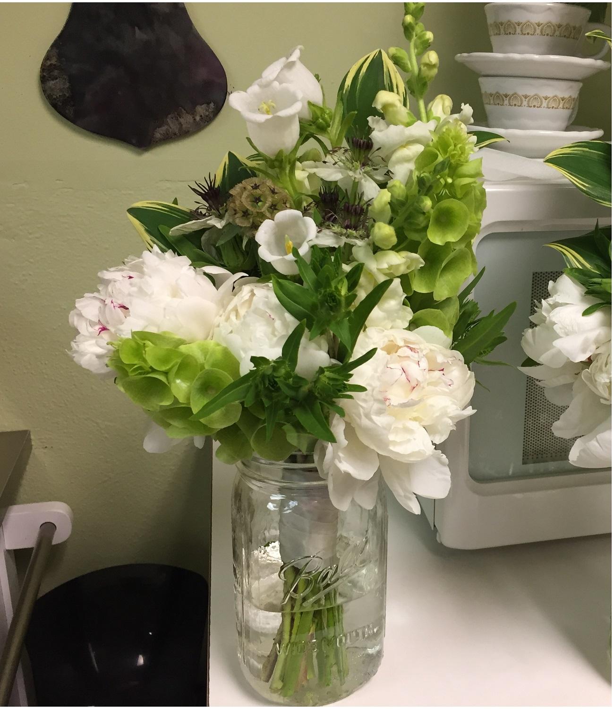 Snapdragon, bellflower, bells of ireland, starflower, peony, variegated solomon seal