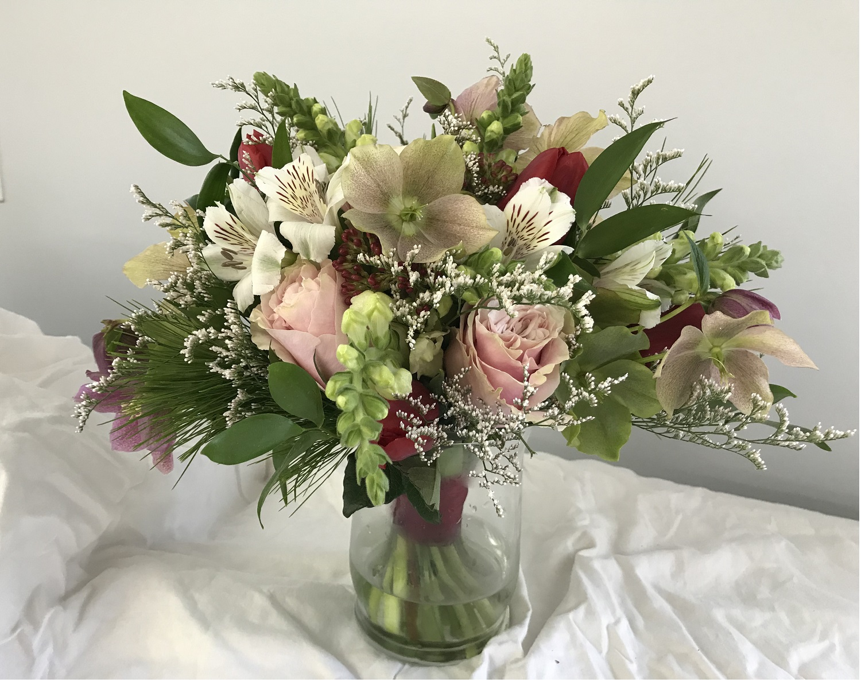 Sara's bouquet—hellebore, alstroemeria, snapdragon, white pine, statice
