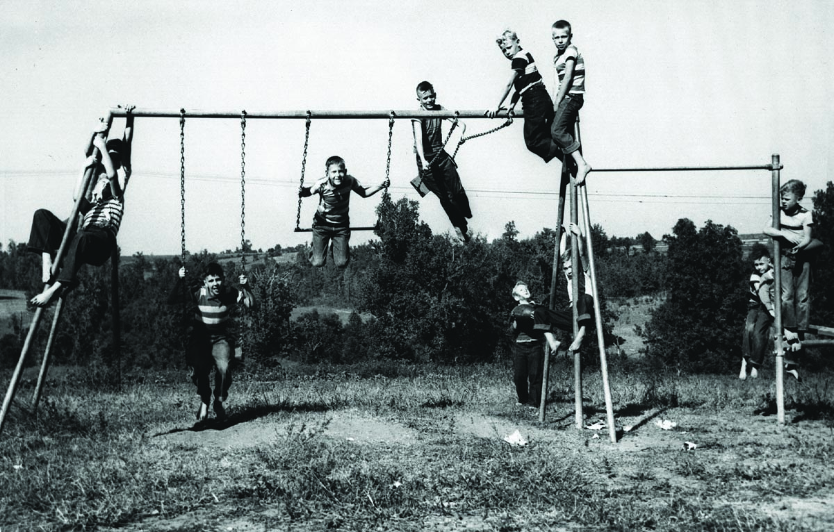 Boys playing behind their cottage
