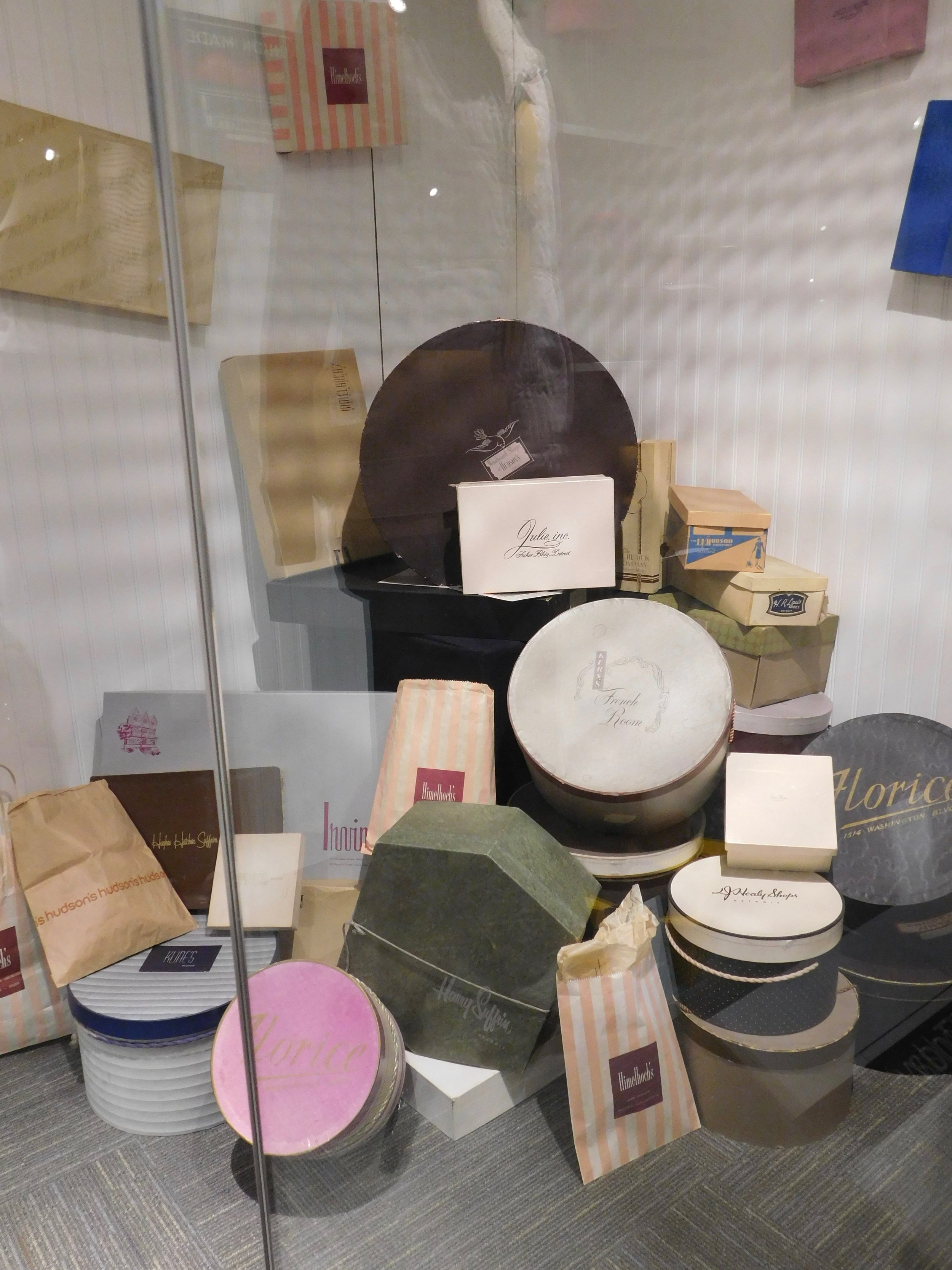 Hat boxes and shopping bags from Detroit retailers.