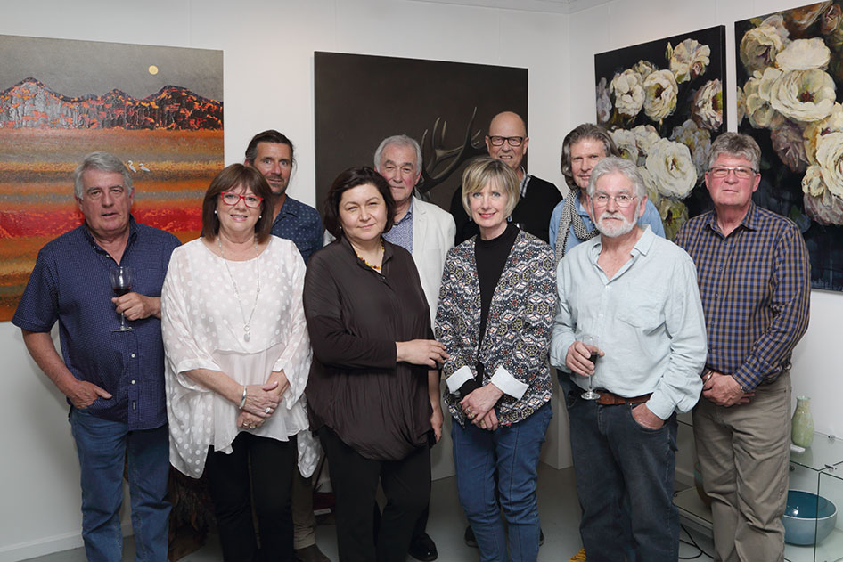 Participating artists of the Heartfelt Exhibition with Artworx owners Liz and John Francis. Photo by David Woolaway.