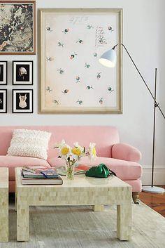 pink sofa and white walls