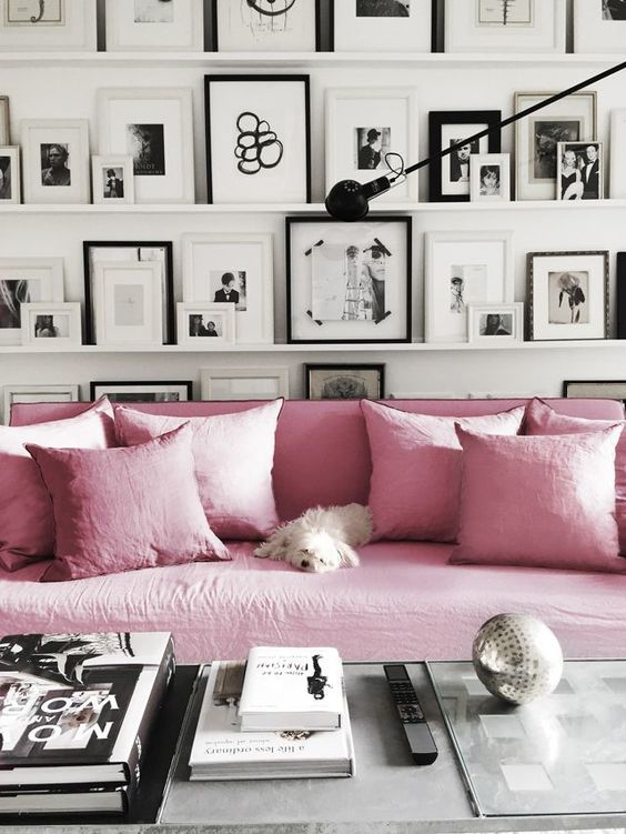 Dreamy pink sofas and tones of picture frames.