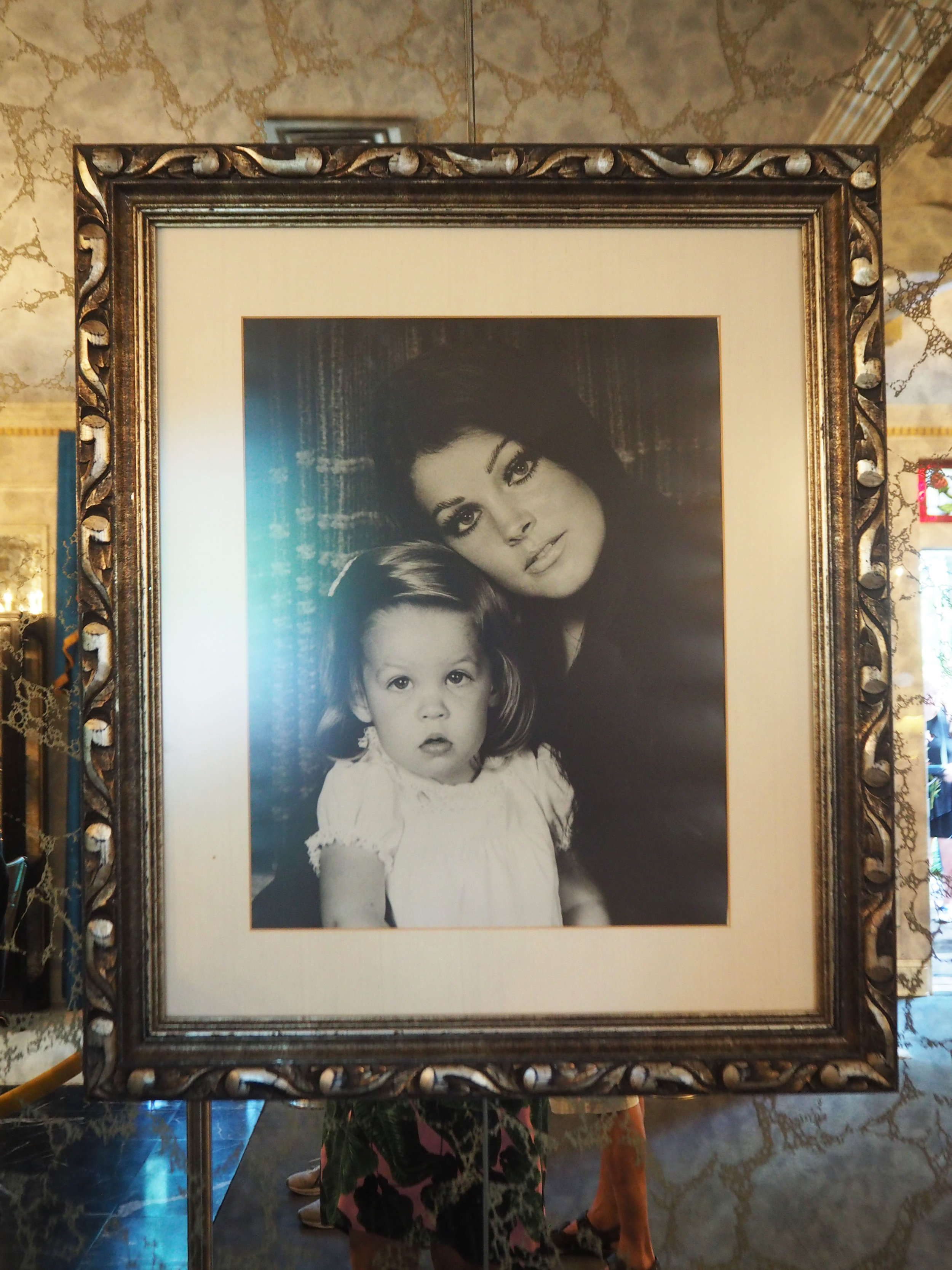 A portrait of Priscilla Presley with her daughter Lisa- Marie, hung inside the dining room inside Elvis Presley's Graceland. To see more pics, click on the photo.