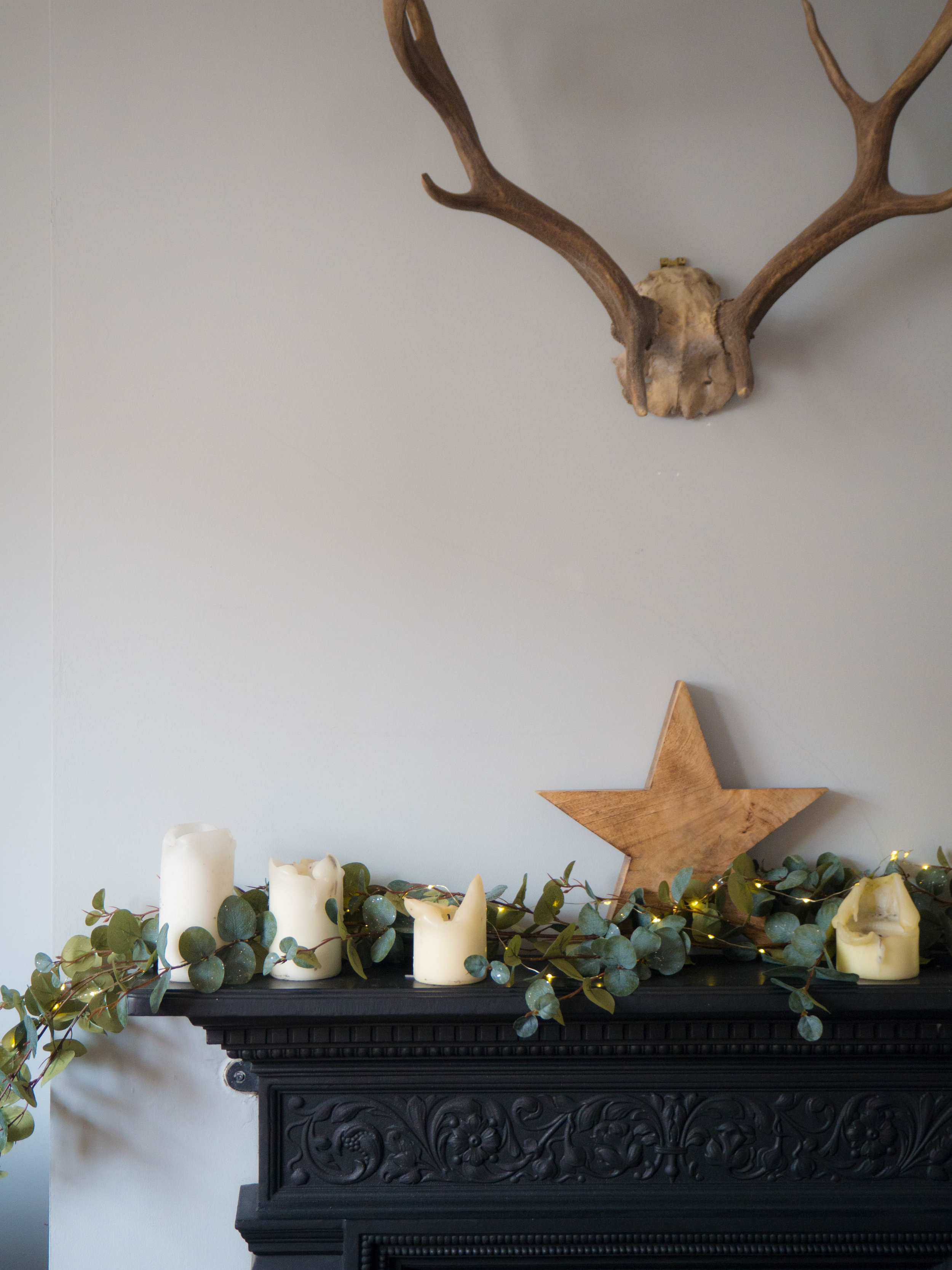 Fire place mantle with Faux garland. Christmas decorations on the blog.
