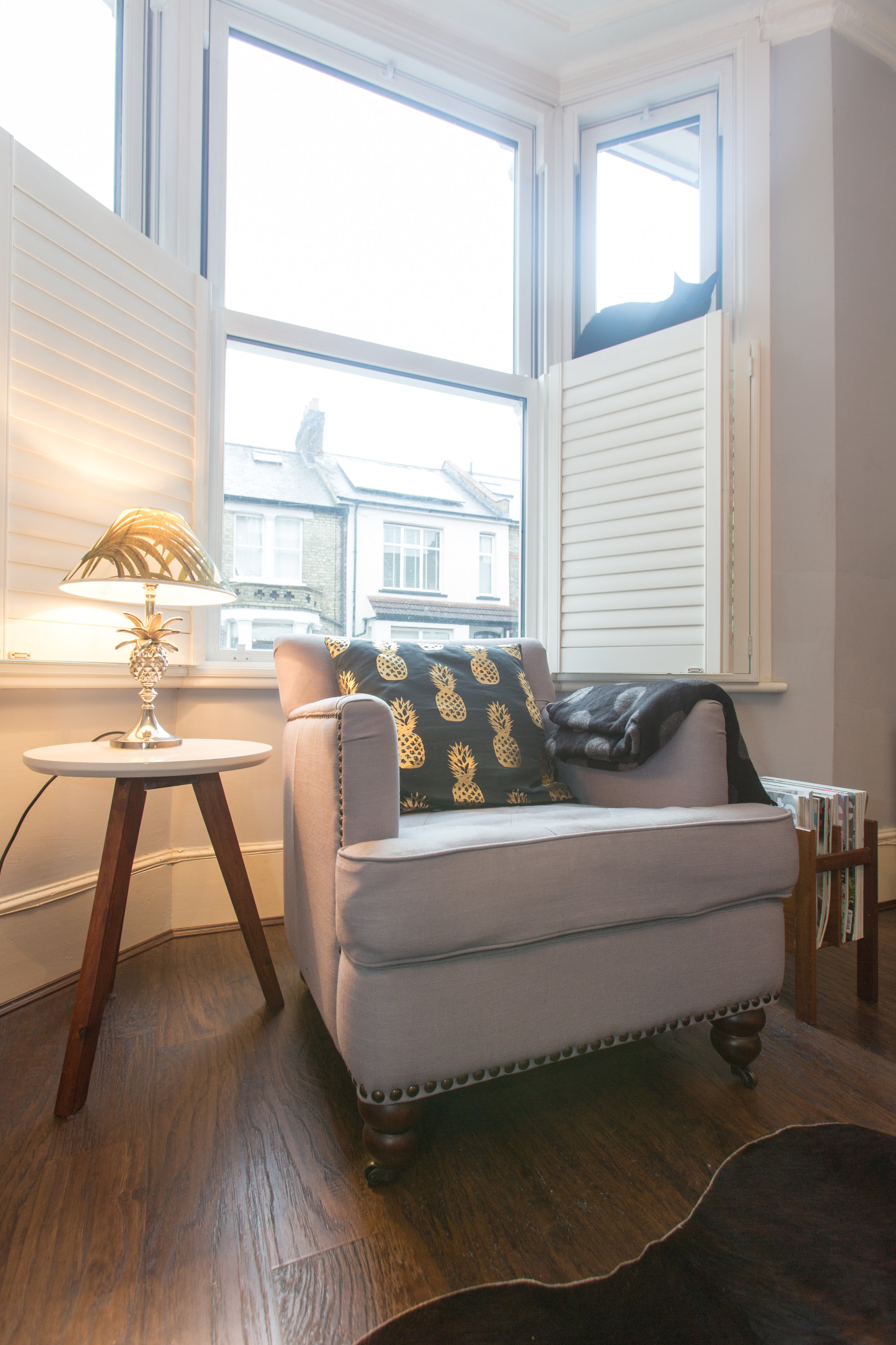 A corner of my house, with my made.com flynn chair and house of hackney pineapple lamp shade.