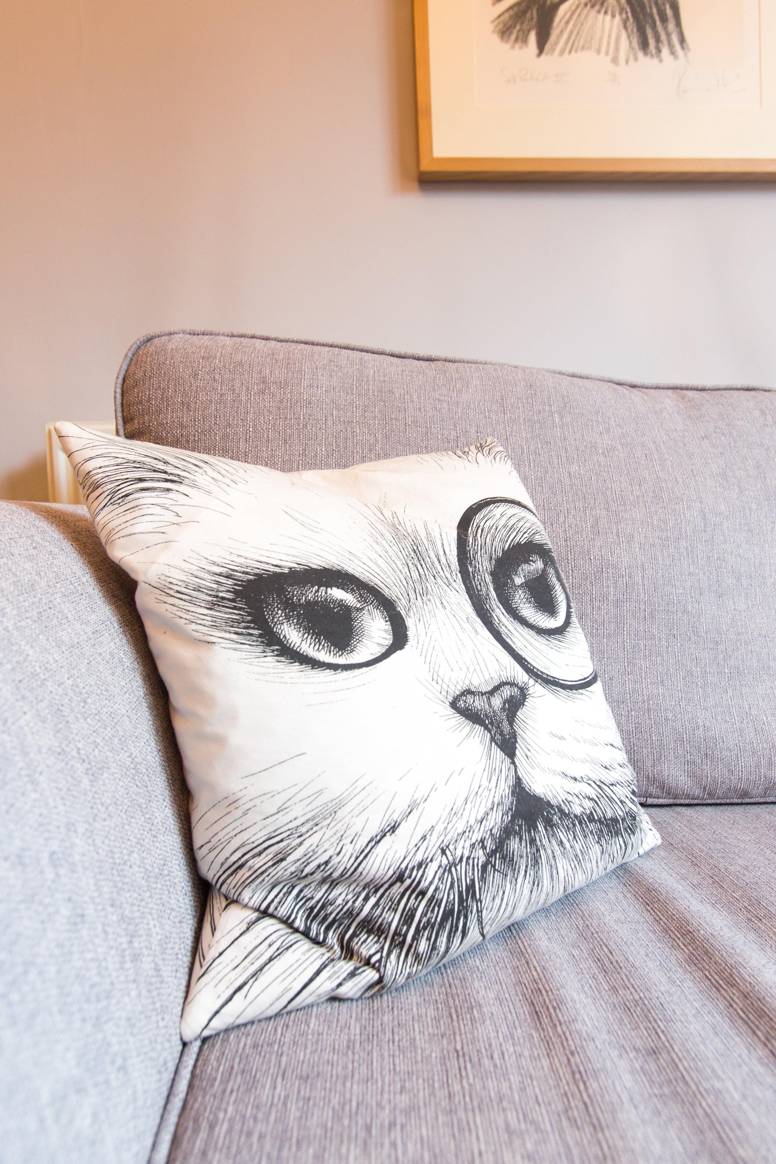 Rory dobner Monocle cat cushion.