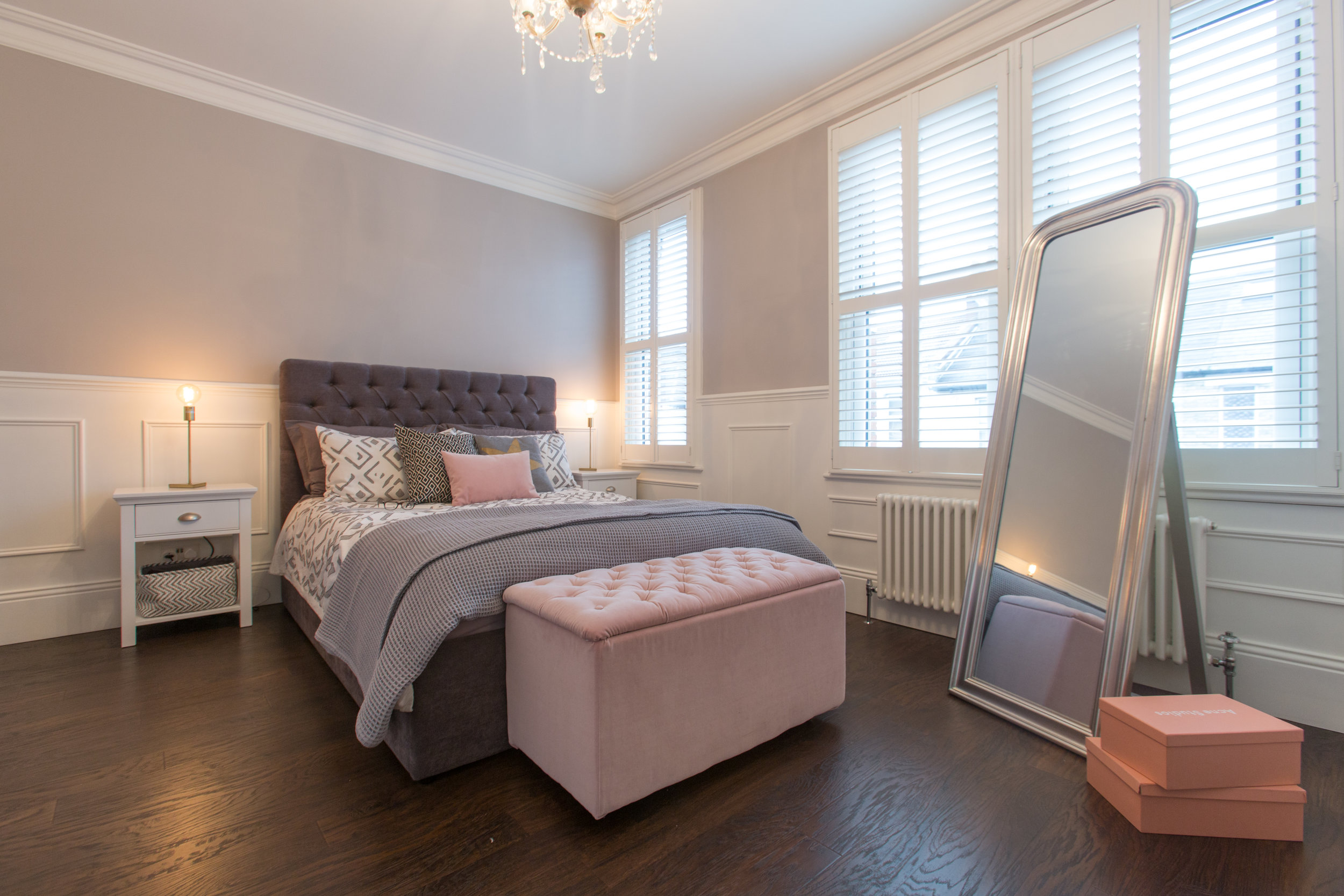 Panneled wall, white and grey bedroom