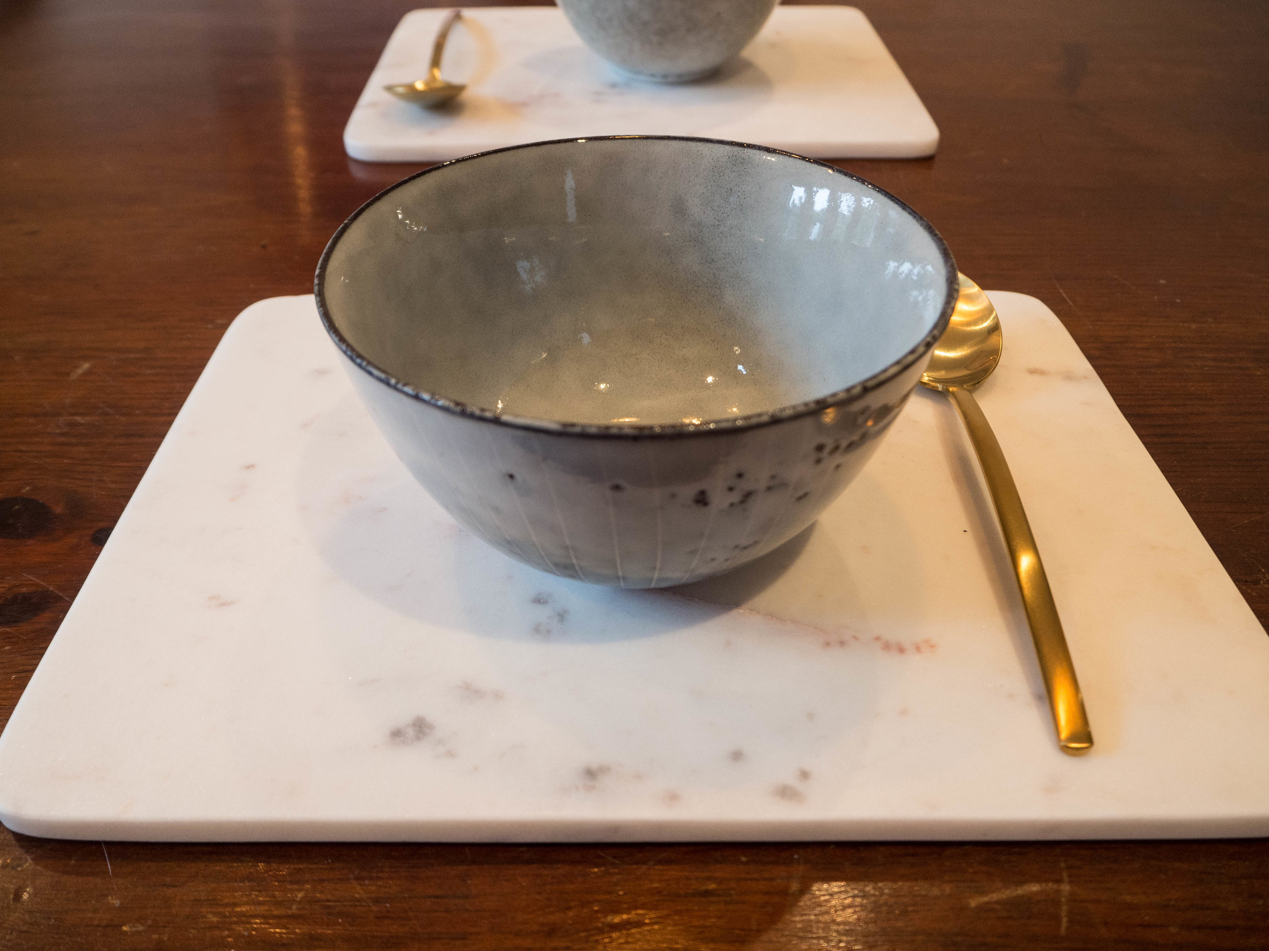 My marble placemats and brass cutlery.