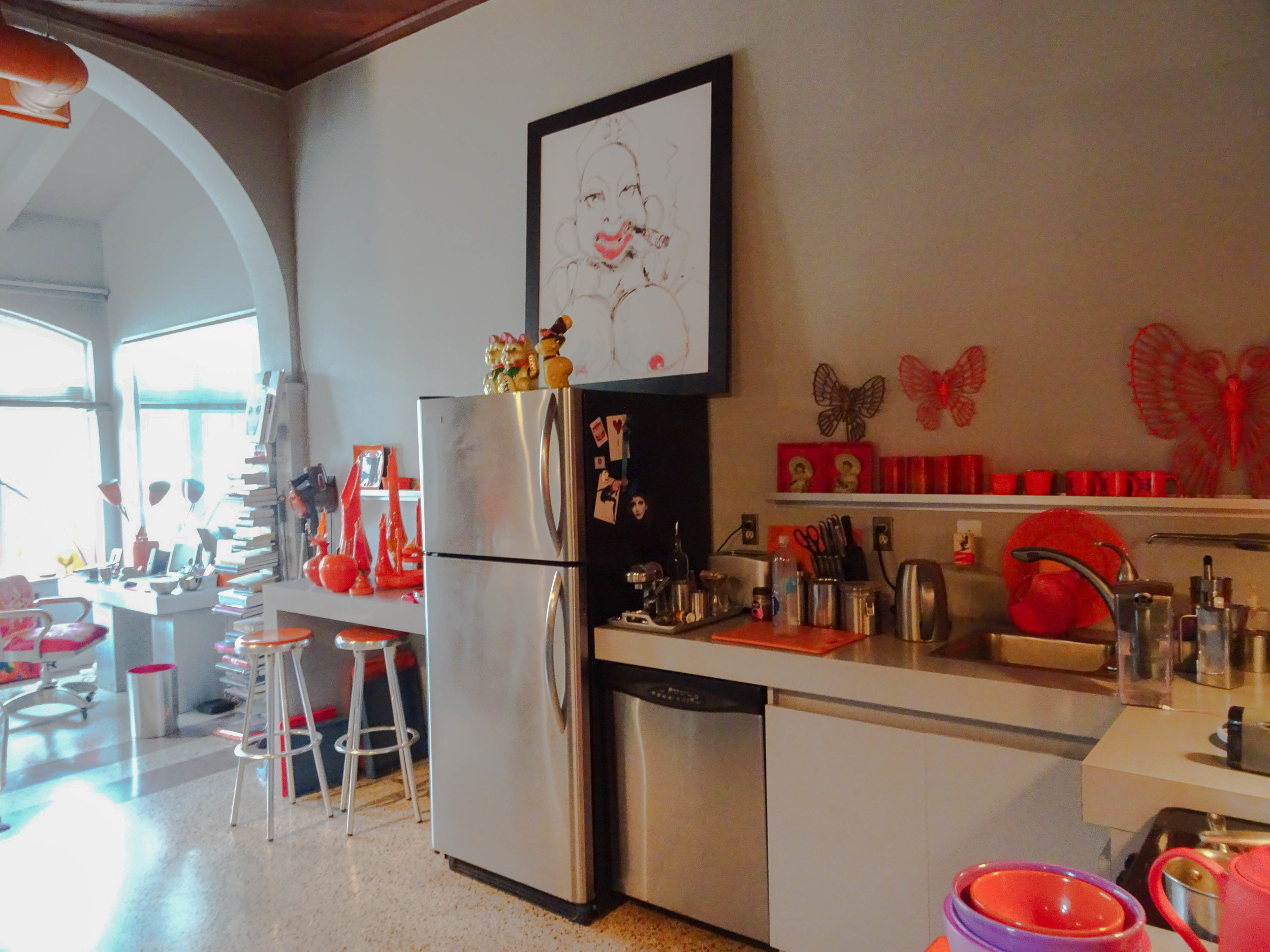 Steel and orange kitchen.