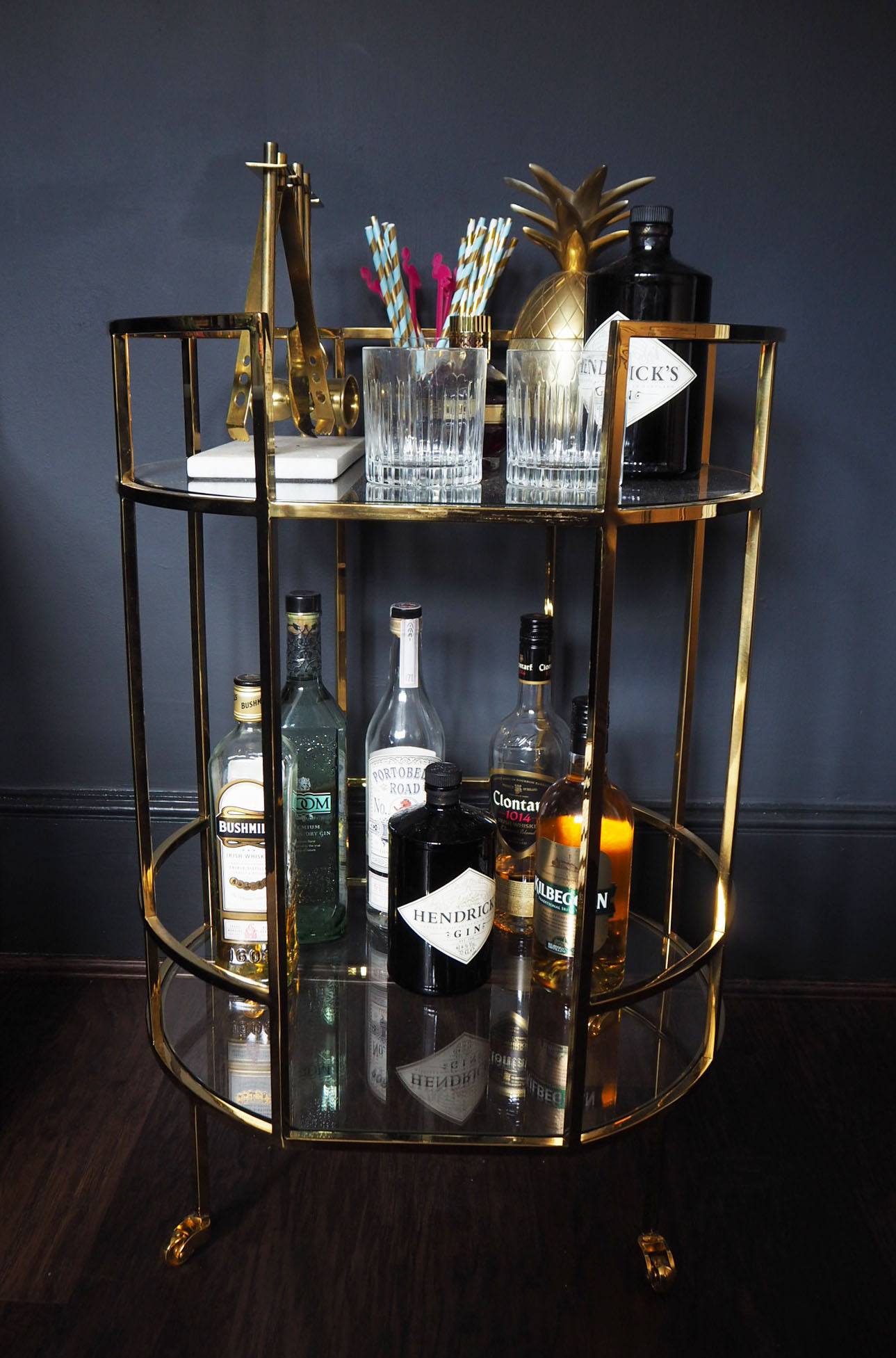 Marks and Spencer Barclay brass bar cart with West Elm bar accessories