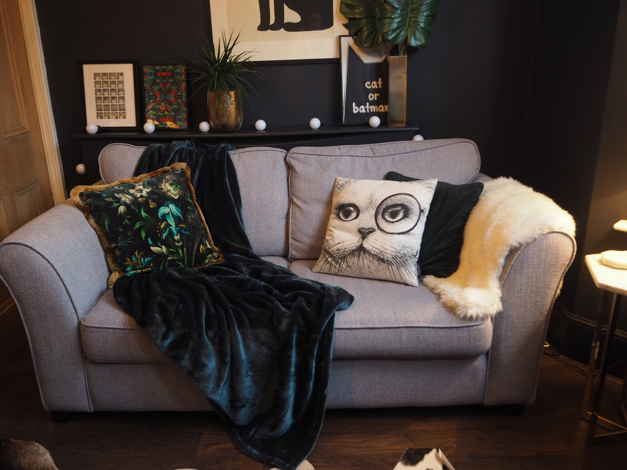 Cosy Autumn update with a plush green throw in the dark lounge