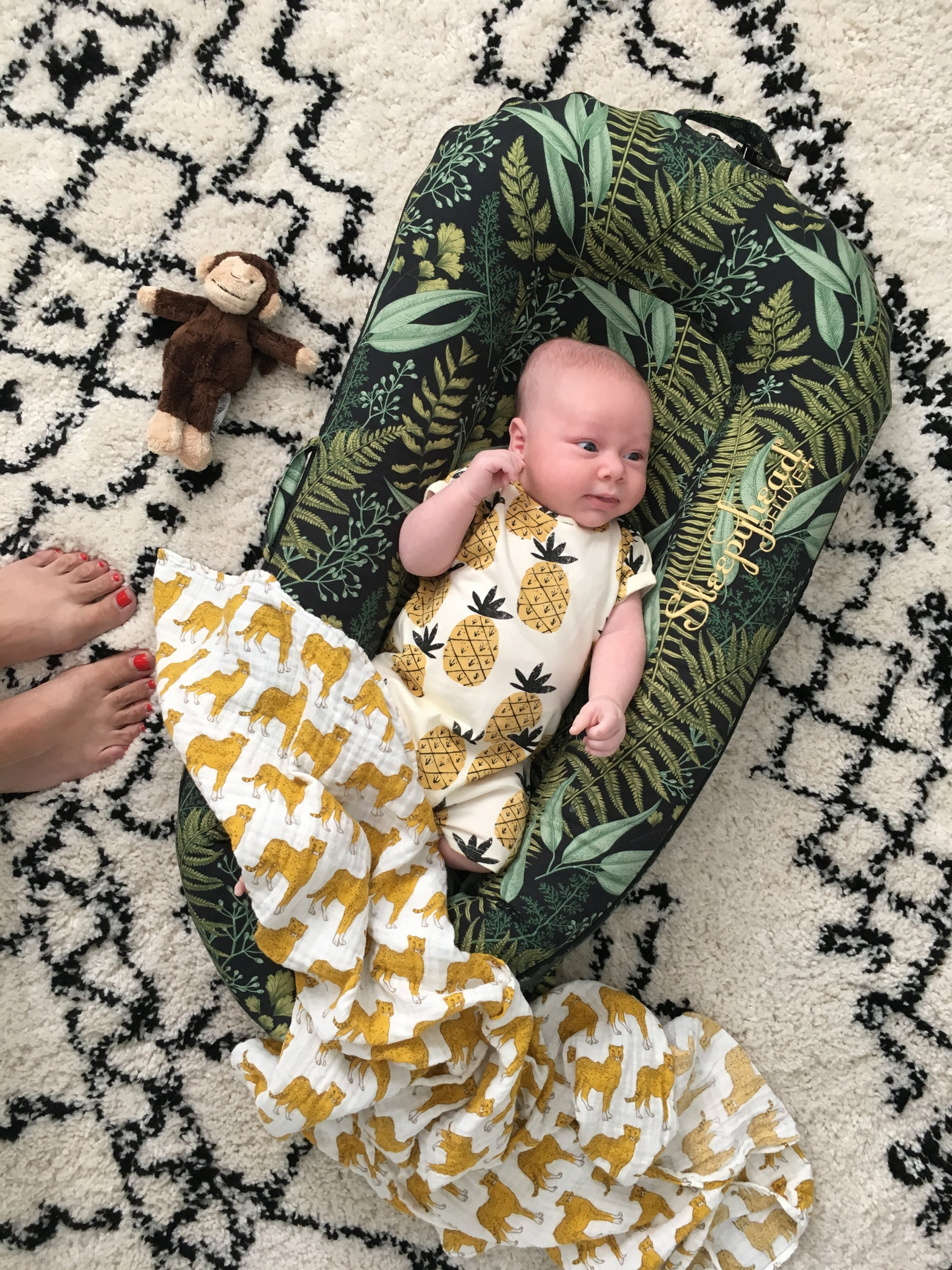 Night falls   sleepyhead deluxe+   85 euros, Leopard muslin £18.50 from   crane bump and baby ,  Pineapple romper £6 from   next