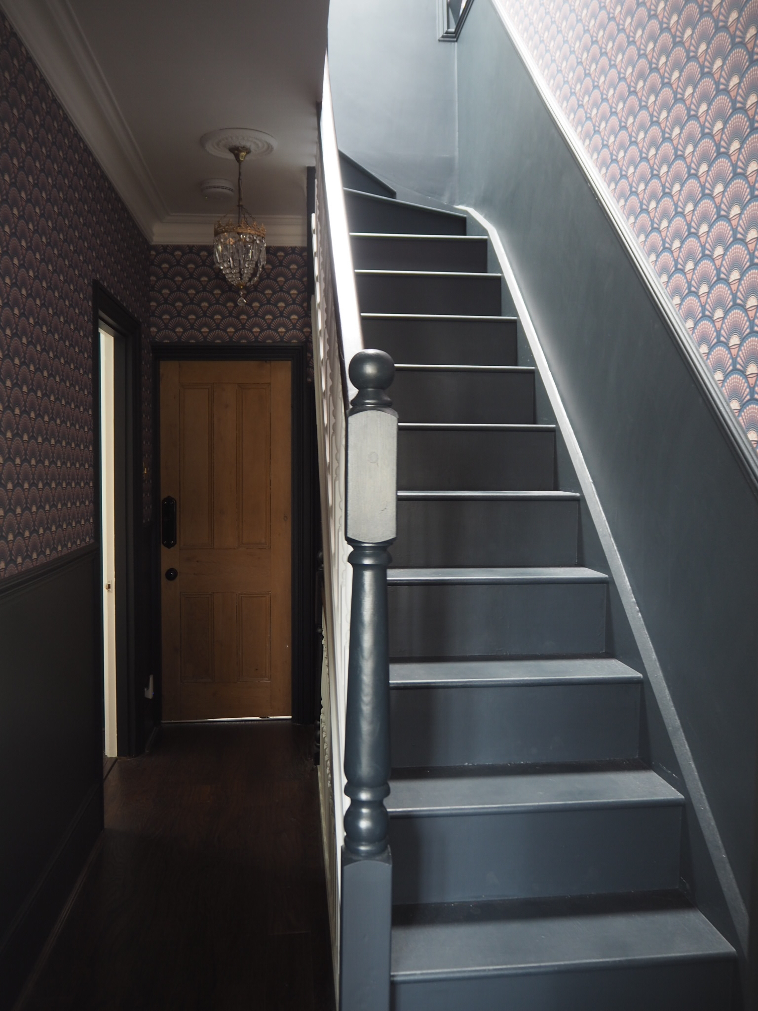 Hallway with deco martini wallpaper and dado rail