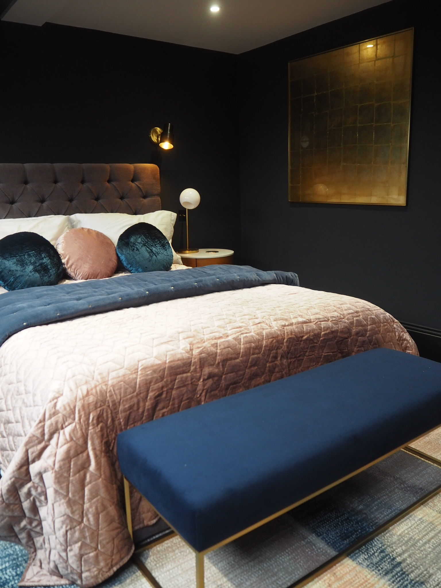 Gilded wall art £299  , from West Elm.   Box upholstered bench in navy and gold  , £499 from West Elm.