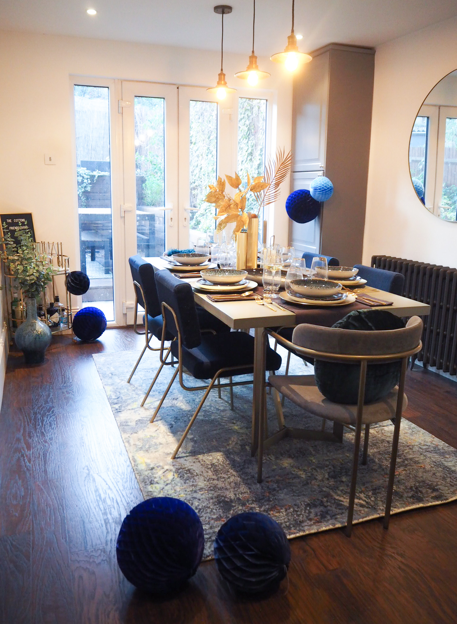 Orion Rug   £499,  from West Elm,   Tower dining table   £899 from West Elm.   Grey Lenox dining chair    £249 from west Elm