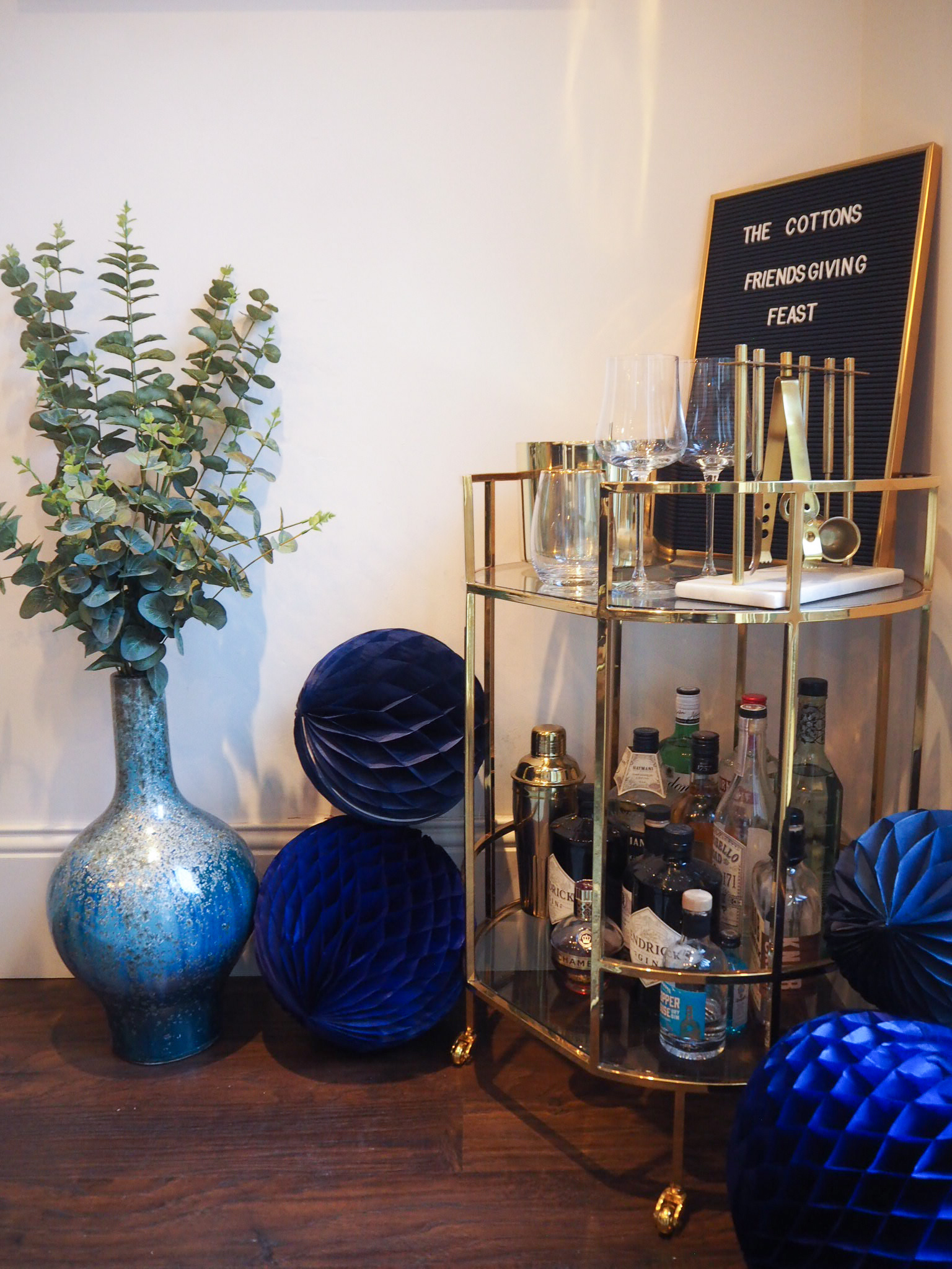 Blue Reactive glaze vase   £79 from West Elm. Drinks Trolley old Marks and spencer. West Elm do similar;   Deco barware set   £79, West Elm