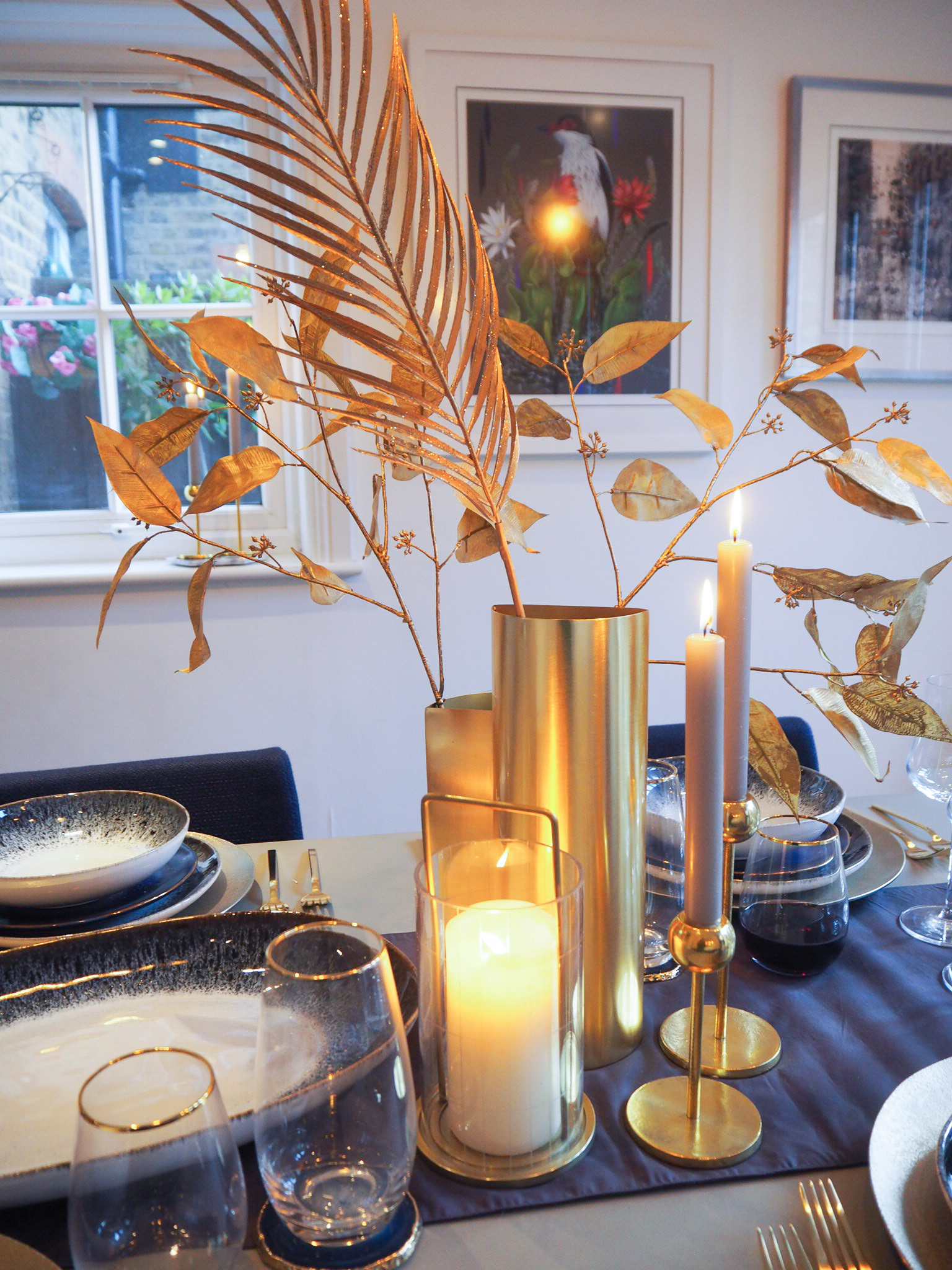 Half circle metal vase   £49, West Elm;   Modern Brass candle holders   from £32;   Large glass hurricane   £59, West Elm.