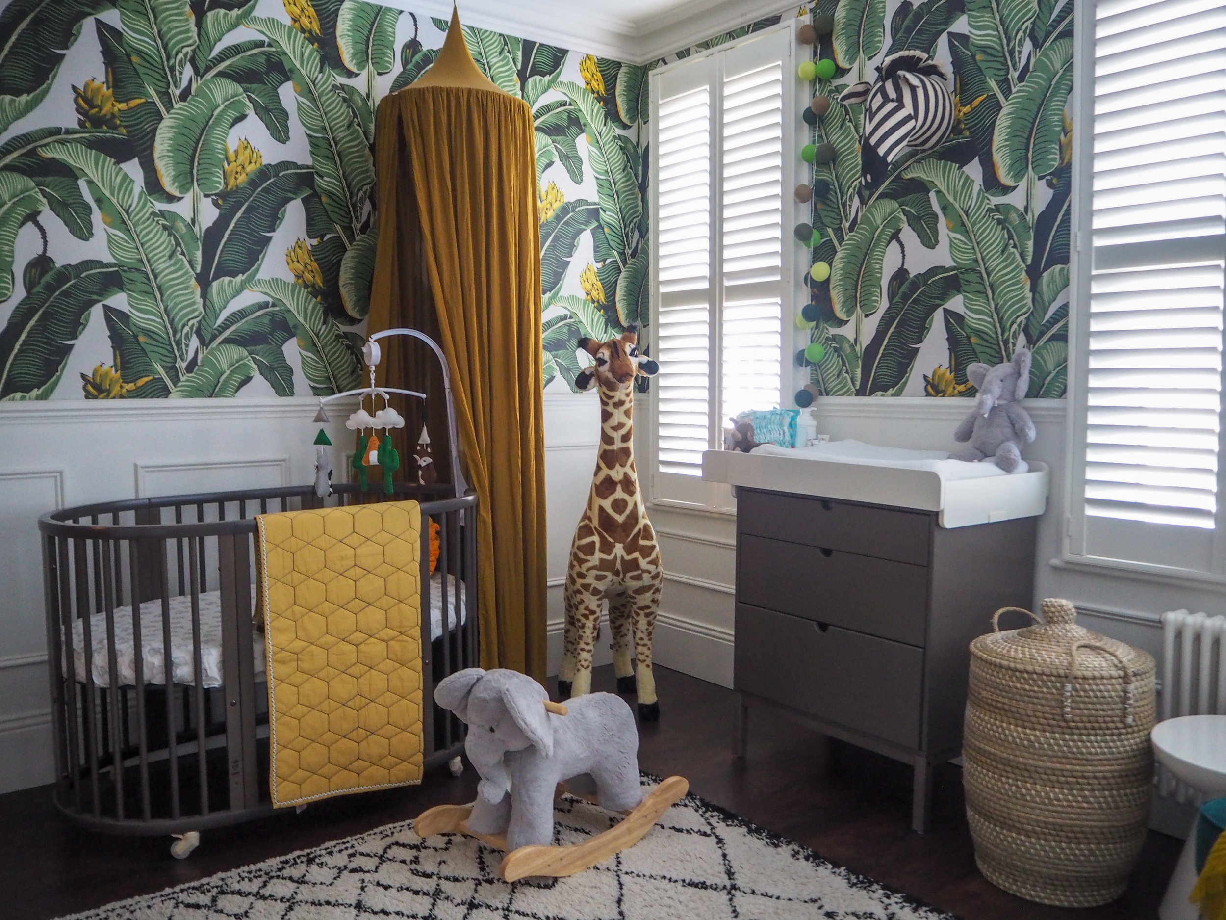 Elephant plush rocker   £149 from Pottery barn kids;   Honeycomb Baby Bed    quilt  £79 from Pottery barn kids;   sleepi cot in grey   £575 from Stokke;   Melissa & Doug Plush Giraffe   £84.99 from Argos.   Zebra animal head   prices from £29.99 from Fiona walker England.